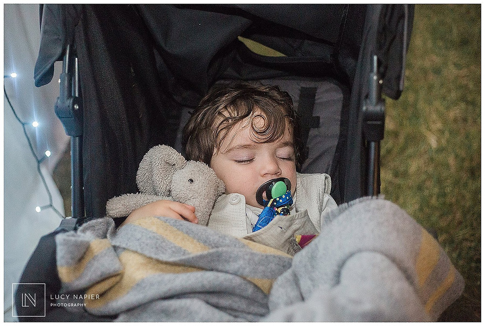 little boy sleeps in his pushchair