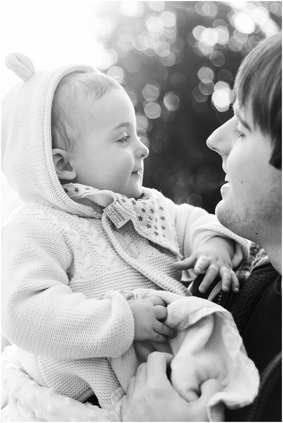 father and son look at each other black and white image