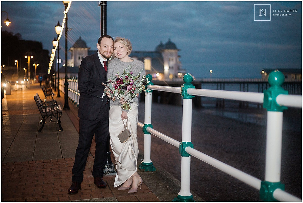 night time couples portraits on Penarth Pier