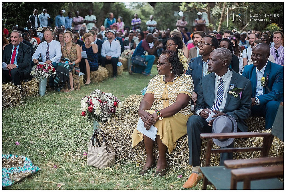 the grooms parents watch their son marry