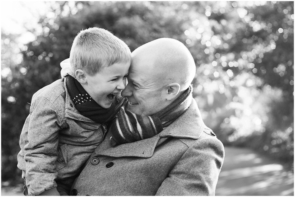 father and son laughing black and white image