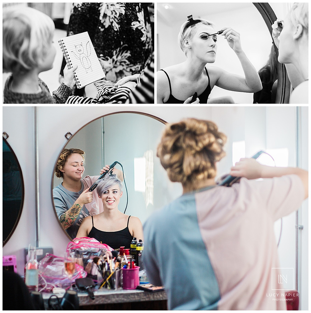 the bride does her make up in the mirror and has her hair done for her wedding