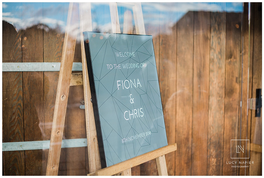 Welcome to the wedding of Fiona and Chris sign at Owen House Wedding Barn