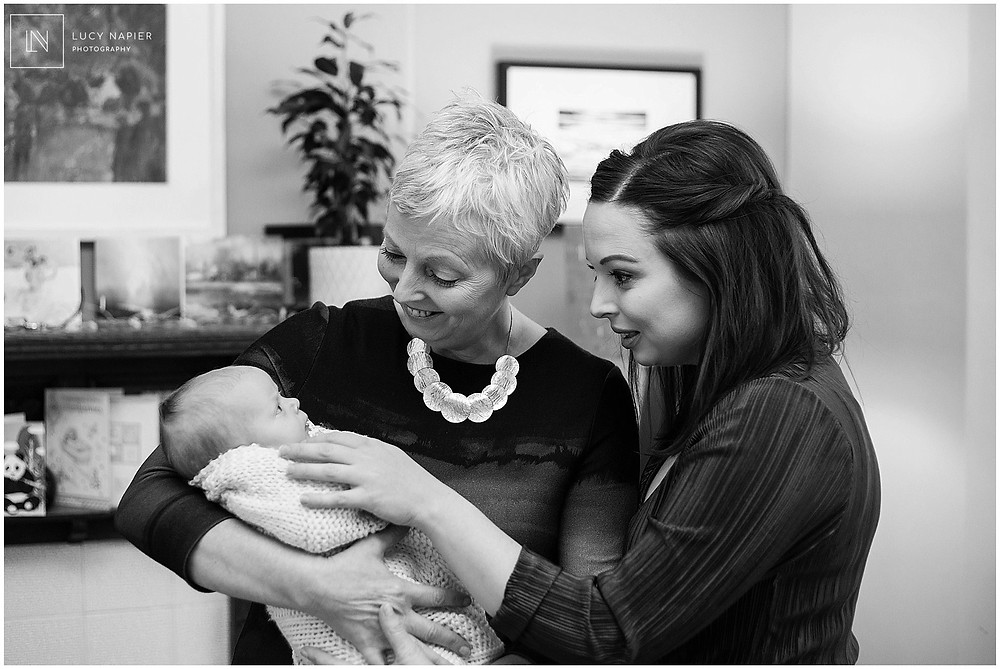 baby in the arms of grandma