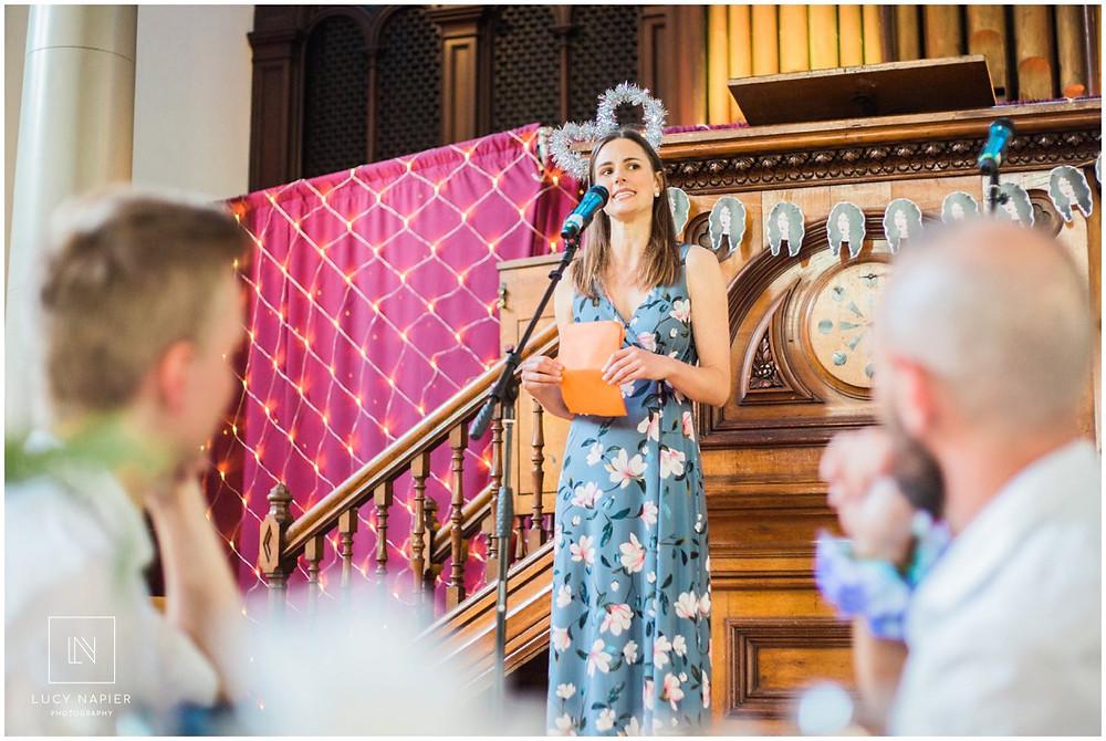 woman does a speech at a wedding