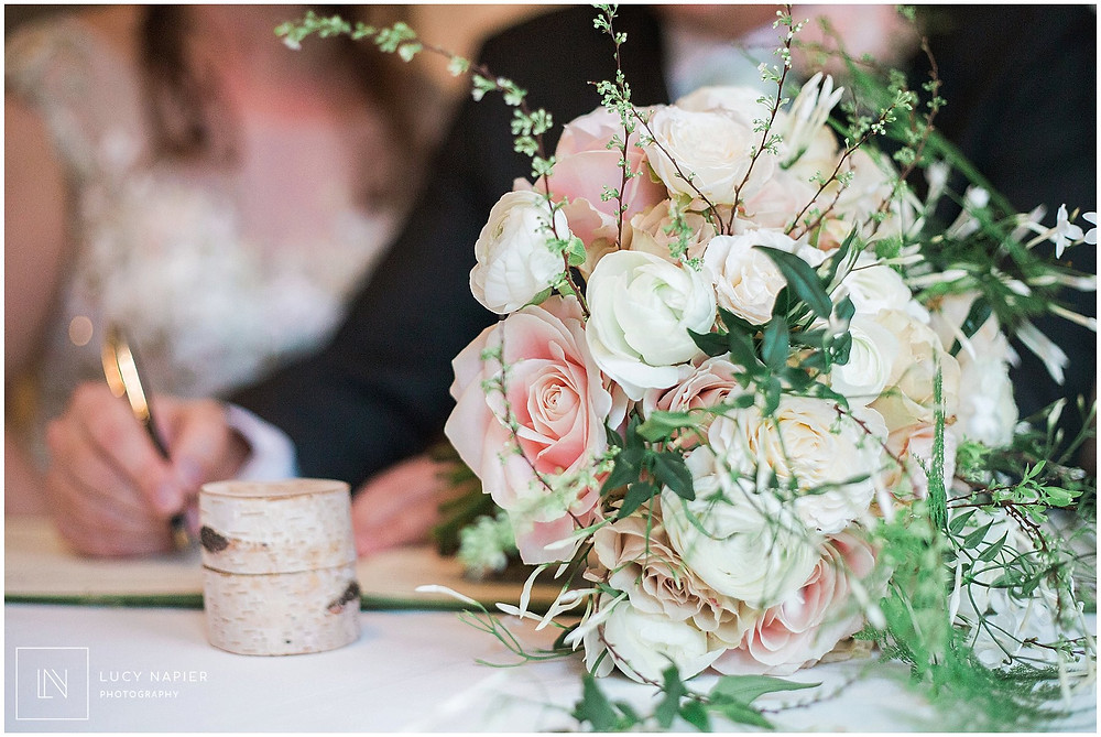 the bouquet sits on the table at the signing of the register