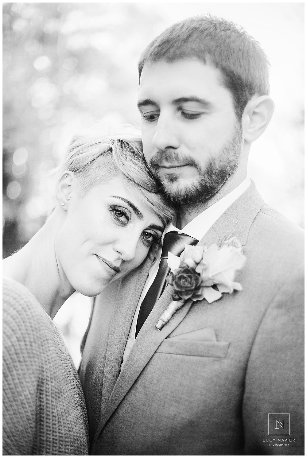 Bride and Groom snuggle, close up back and white portrait