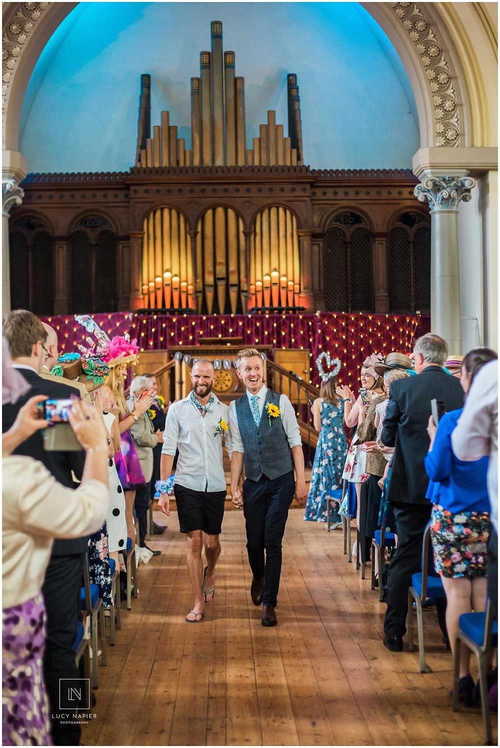 the grooms walk back down the aisle after getting married
