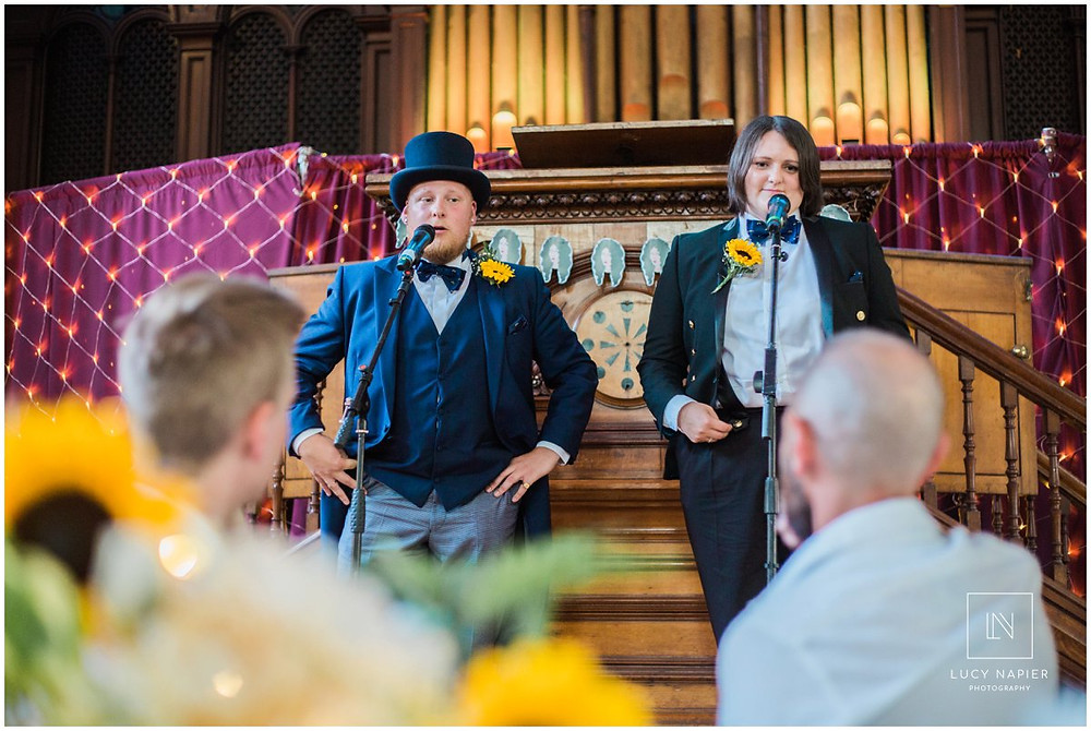 man and woman in top hat and tails do a speech