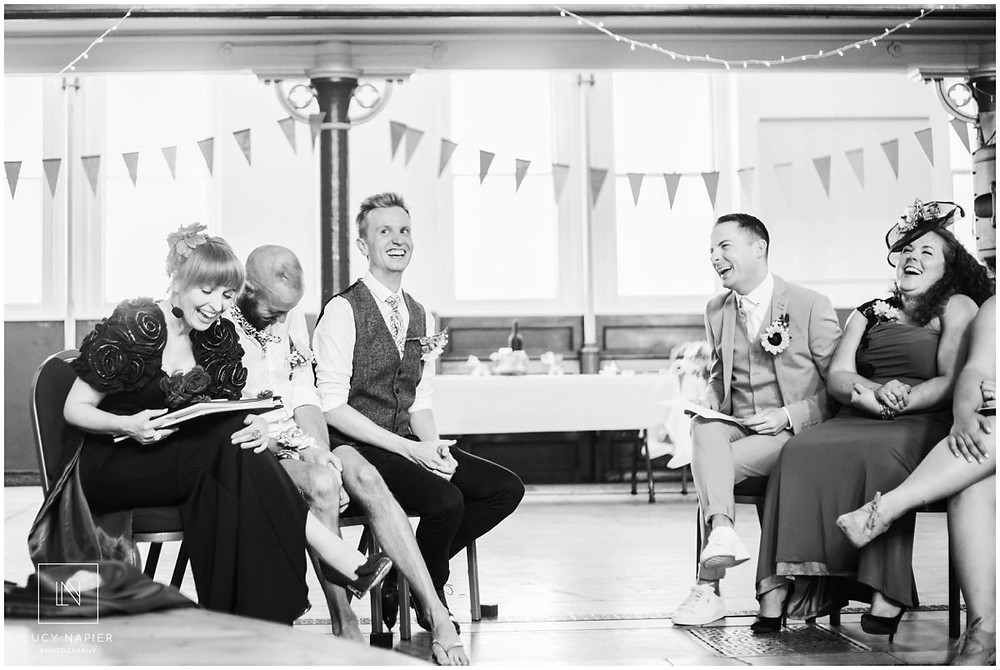 the grooms laugh hysterically at a performance of Victoria Wood's let's do it