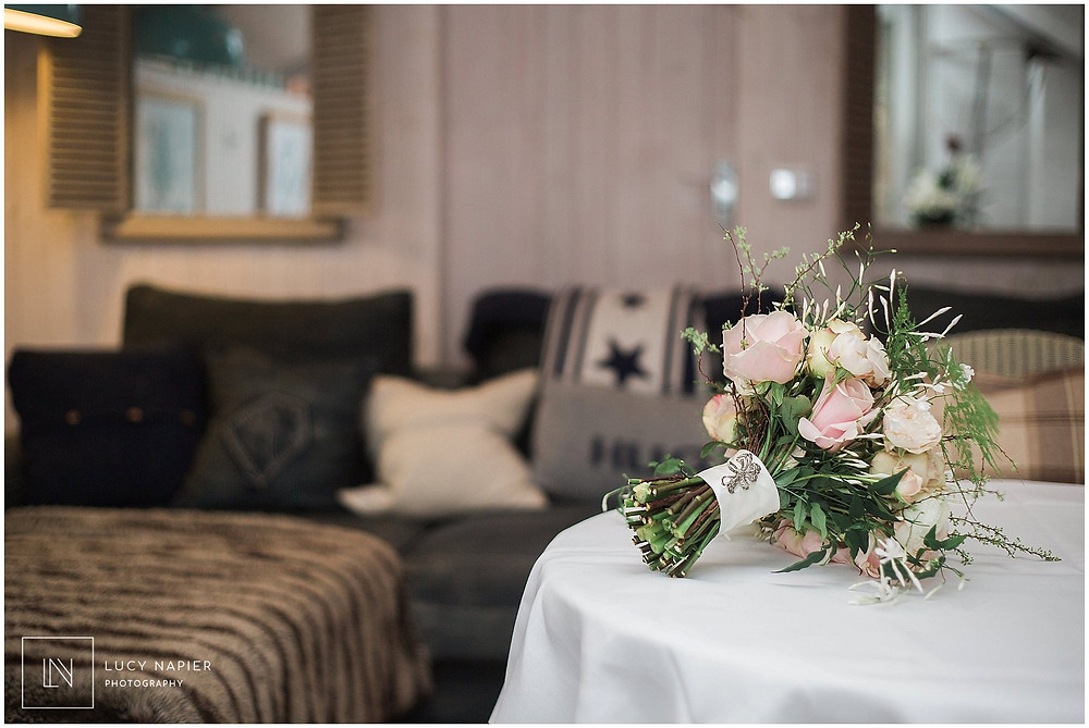 the bridal bouquet sits on the table at the Gilpin Hotel and Lake House