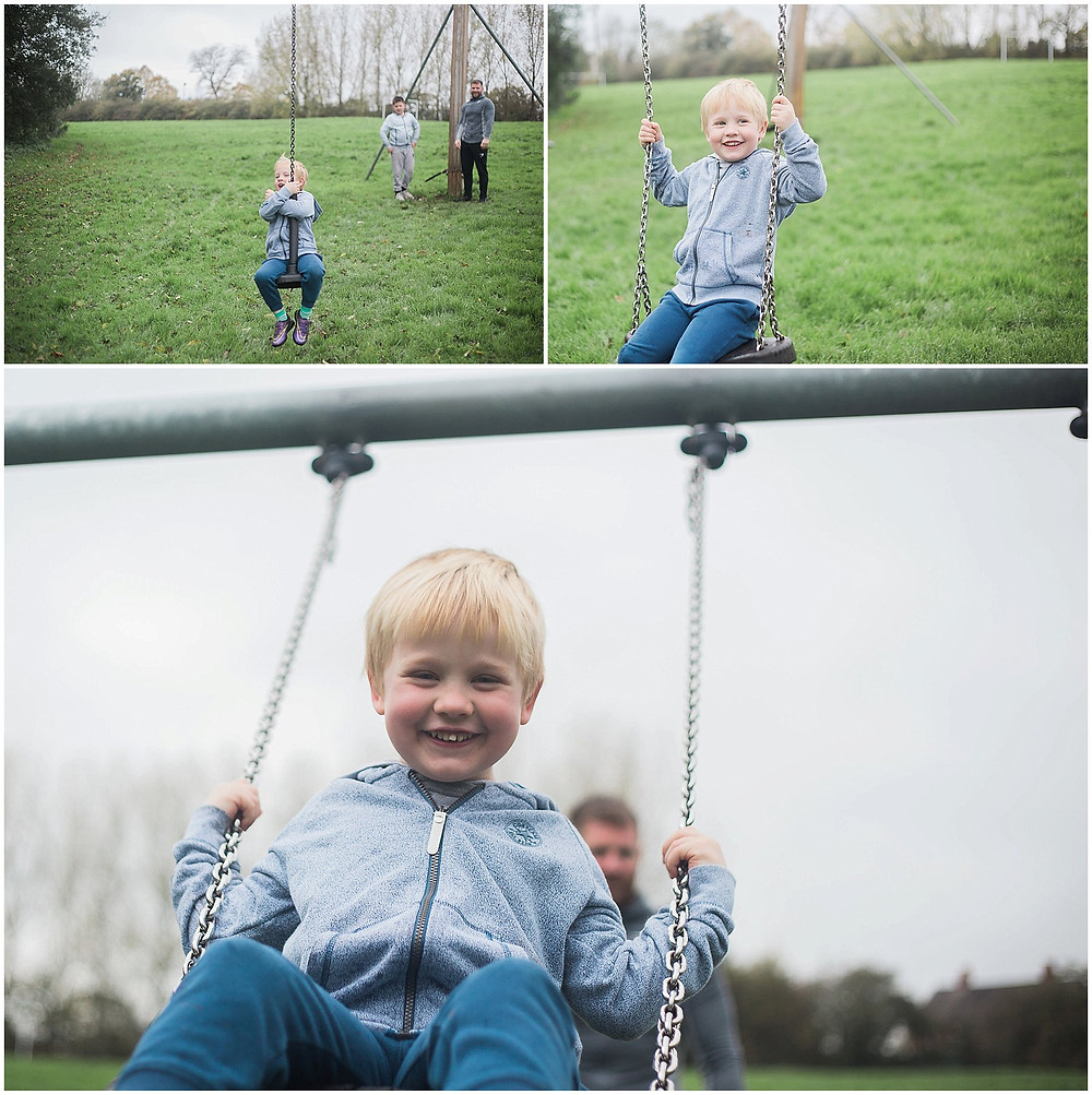 smiling boy on a swing