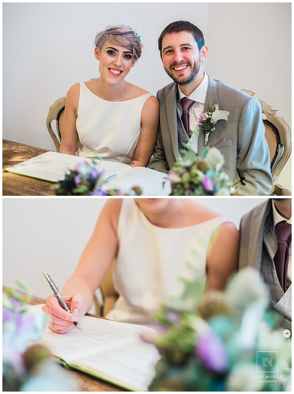 the bride and groom sign the register in Owen House Wedding Barn