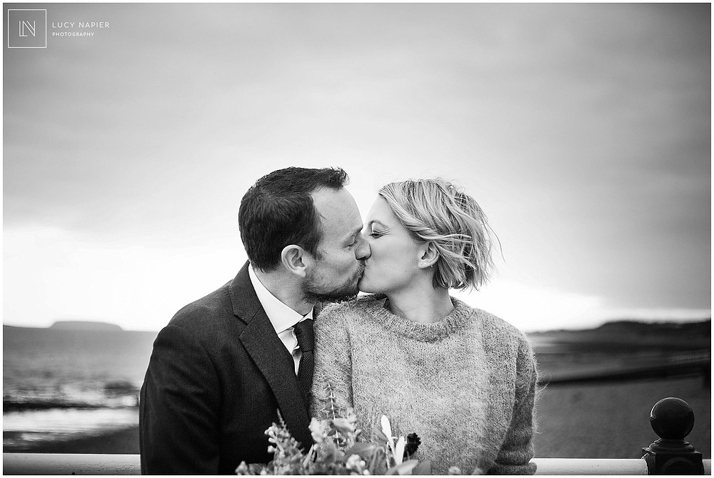 first kiss on the pier at Penarth welsh wedding photography