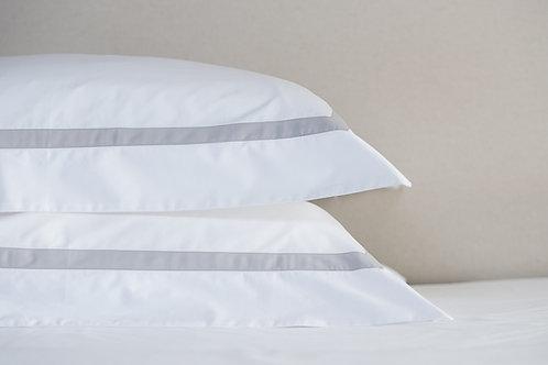 Savile Edge stacked oxford pillowcases in white silver