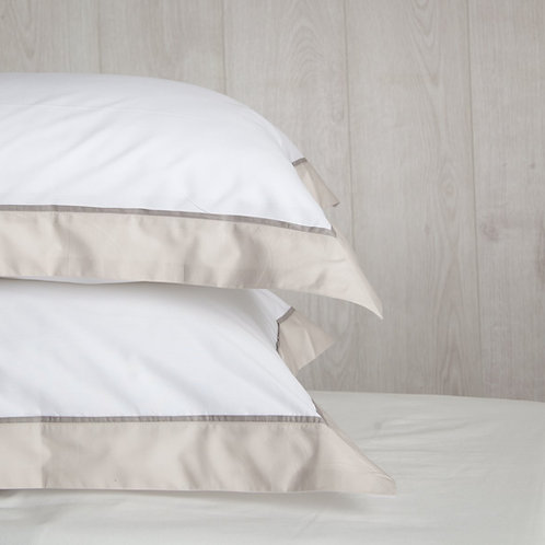 Stack of pillows with Carnaby Tailored white dune dark grey pillowcases