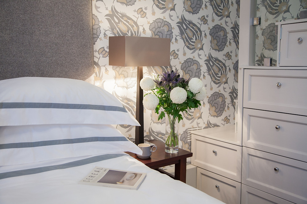 Beautifully displayed bed with white bedding