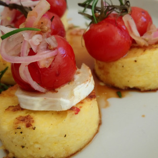 Polenta fritters with roasted tomatoes.