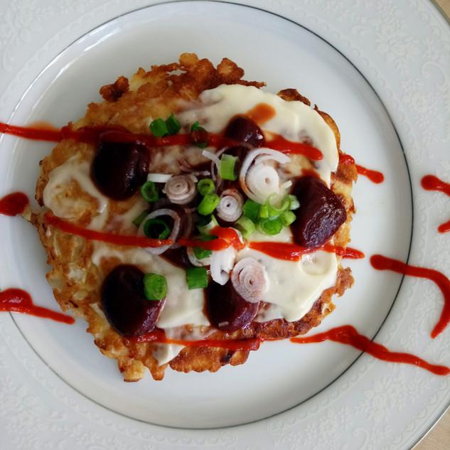 Japanese cabbage pancakes, served with my own handmade okonomi sauce.