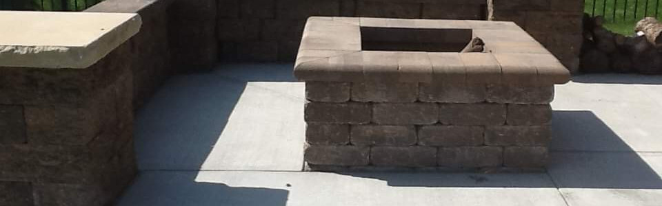 Retaining wall with a touch of a firepit!