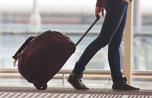 Person Rolling Suitcase in Airport_edited.jpg