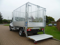 Caged Tipping Body with no Roof and a Dump Over Tail Lift in the down position