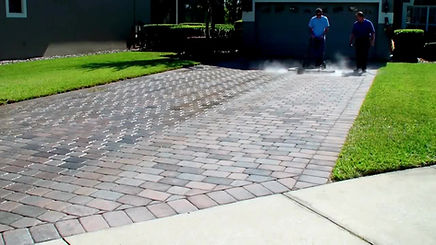 Pressure cleaning a 1500 Sq. Ft. driveway in 7 minutes.