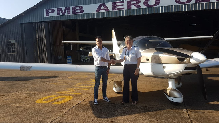 Flight Instructor Telani congratulating Alistair