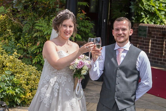 Wedding Photography Portsmouth- Couple rise a glass in celebration