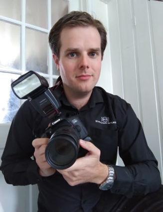 Wedding Photographer holding the camera.