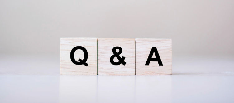 q-word-with-wooden-cube-block-faq-freque