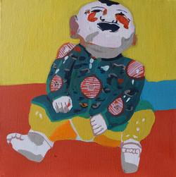 Enfant riant assis