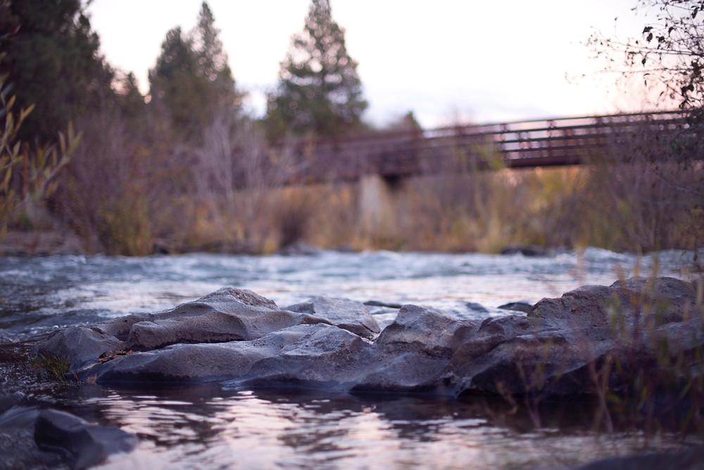 crossing the bridge over the river