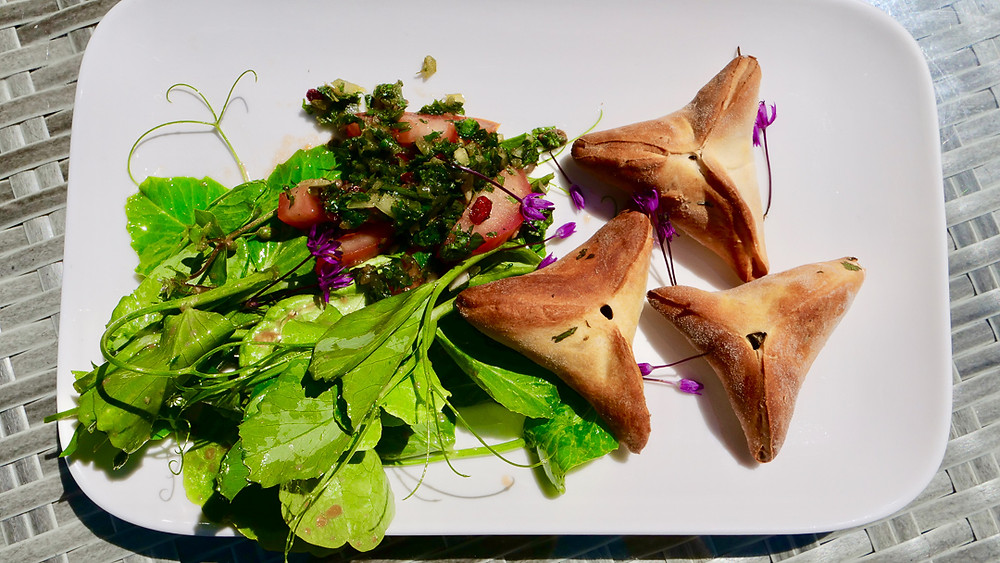 Ground Elder Fatayer with a wild herbs salad and pea shoots
