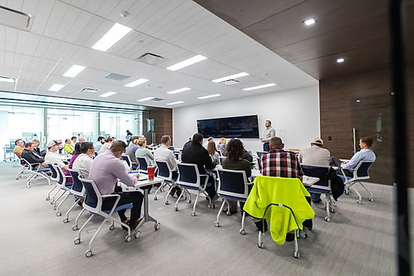 Every Monday, Zwick Construction gathers together in their respective offices to discuss the core values: passion, integrity, and teamwork.