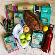 Instagram Giveaway with brand Onya to promote 1 Million Women's LoveEarth Festival and Onya as a partner. Image shows a range of Onya products in a flatlay with props such as a loaf of bread and apples.