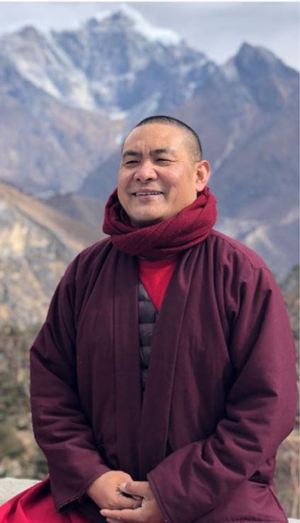 Lama Tendar in Front of the Himalayas.JP
