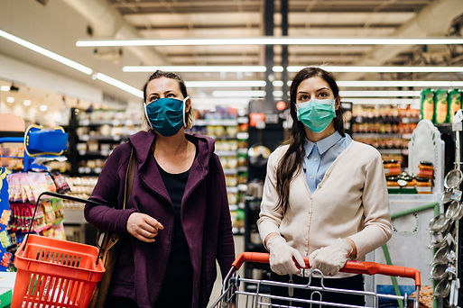 Shoppers with masks buying for groceries