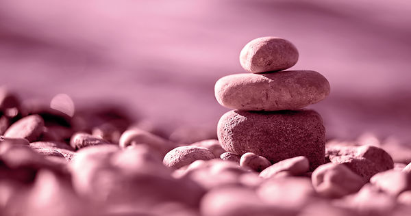 Website banner of Zen balancing pebbles