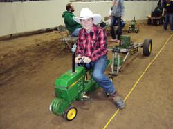 Even cowboys love tractor pulls