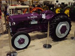 purple antique tractor