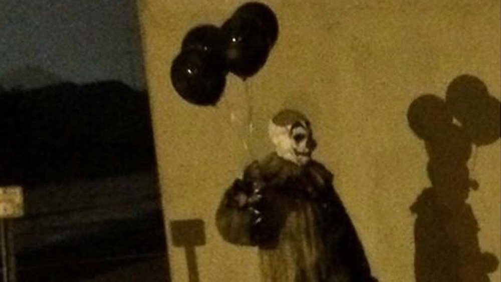 Gags the clown strolling the street.