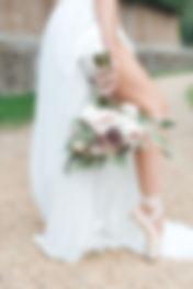 ballerina bride holding bridal bouquet