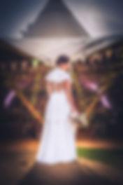 bride in the rain holding bridal bouquet