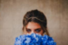 Blue eyed girl holding blue hydrangea bouquet