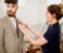 Gemma Hales Iris and Co wedding florist attaching buttonhole to groom london