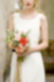 bride holding bridal bouquet in derelict church