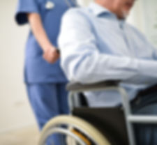 Nurse pushing an injured patient on a wh