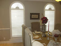 Plantation Shutters with hidden tils and arch