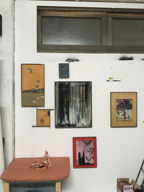 Studio view with some paintings and ceramics.